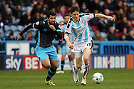 Alex Lopez of Sheffield Wednesday (l) and Joe Lolley of Huddersfield Town chase the ball. Skybet football league Championship match, Huddersfield Town v Sheffield Wednesday at the John Smith's Stadium in Huddersfield, Yorkshire on Saturday 2nd April 2016.<br /> pic by Chris Stading, Andrew Orchard sports photography.