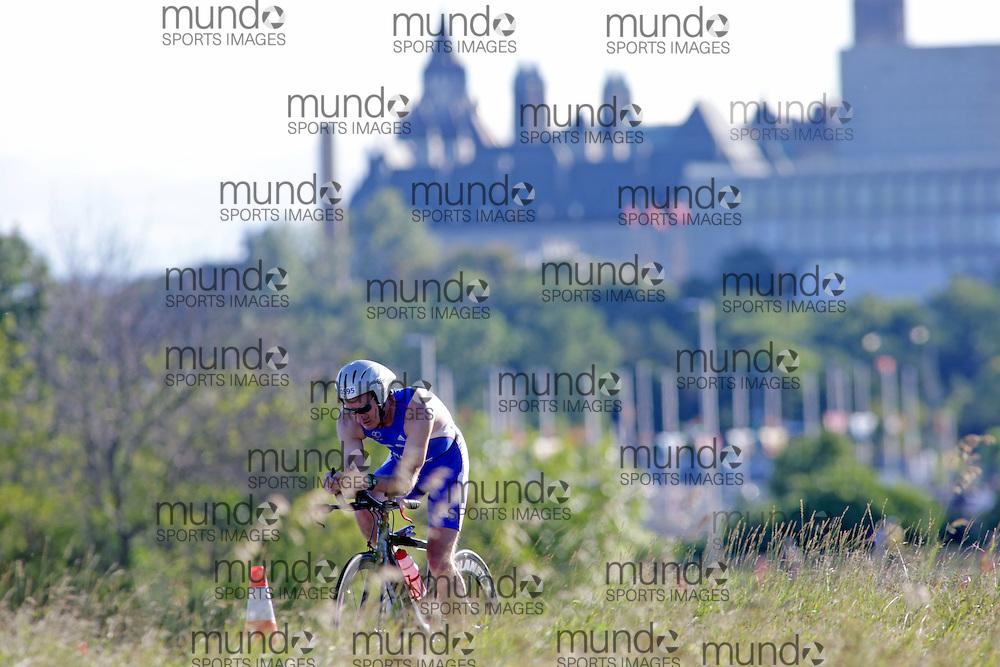 (Ottawa, Canada---10 August 2013)  Peter Neal (595)  of Great Britain (GBR) competing in the 55-59 Male AG International Triathlon Union 2013 World Duathlon Championships (10 km run- 40 km bike- 5km run).