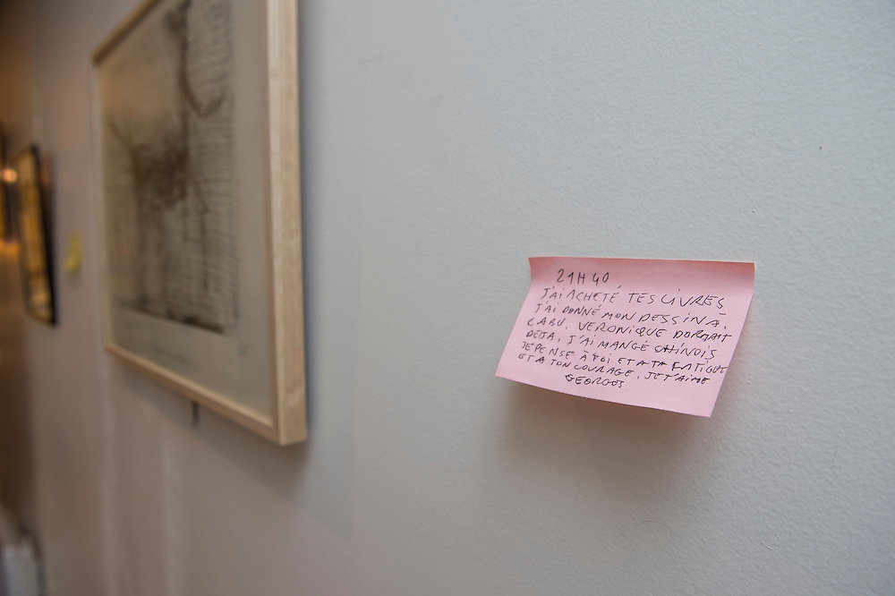 """March 6, 2015, Paris, France. Post-it notes decorate the Paris' apartment where Georges and Maryse Wolinski used to live. French Cartoonist Georges Wolinski (1934 –2015) wrote daily post-it notes to his wife Maryse Wolinski (1943, Algiers). Two month after the death of Georges Wolinski, the apartment is full of souvenirs and notes, attesting a half-century-long love relation: """"9.40 pm. I bought your books. I gave my drawing to Cabu. Veronique was already alseep. I ate in a Chinese restaurant. I think about you, and your fatigue and your courage. I love you, Georges."""" <br /> The cartoonist Georges Wolinski was 80 years old when he was murdered by the French jihadists Chérif en Saïd Kouachi, he was one of the 12  victims of the massacre in the Charlie Hebdo offices on January 7, 2015 in Paris. Charlie Hebdo published caricatures of Mohammed, considered blasphemous by some Muslims. During his life, Georges Wolinski defended freedom, secularism and humour and was one of the major political cartoonists in France. The couple was married and had lived for 47 years together. Photo: Steven Wassenaar."""