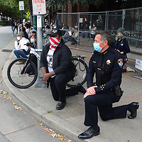 Santa Cruz, California Police Chief Andy Mills takes a knee along with hundreds gathered on Pacific Avenue in downtown Santa Cruz on Saturday May 30, 2020 to honor the memory of George Floyd and bring attention to institutionalized police violence against black people. Minneapolis resident George Floyd was pinned facedown on the ground, in handcuffs, by a white police officer who pressed his knee against Floyd's neck for more than eight minutes. He was unresponsive when paramedics arrived, and he was pronounced dead later.  (Photo by Shmuel Thaler)