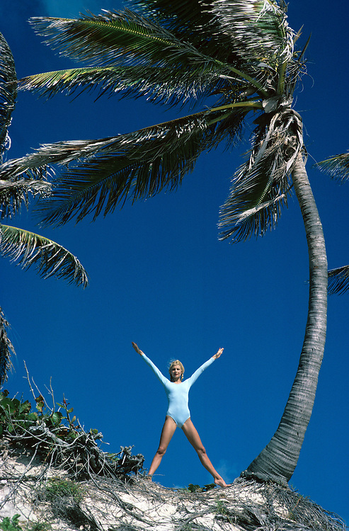 British model Jilly Johnson seen during exercises under a palm tree in Barbados. Photo Terry Fincher