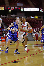 31 December 2009: Shala Jackson works to out maneuver Amber Wollschlager. The Bulldogs of Drake fall to the Redbirds of Illinois State University by a score of 77-58in a Missouri Valley Conference game on Doug Collins Court in Redbird Arena in Normal Illinois.