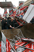 """Moscow, Russia, 13/01/2013..Opposition leader Sergei Udaltsov smashes portraits of Russian politicians into a skip marked """"for garbage"""". Thousands of opposition protesters carried posters of President Vladimir Putin and members of the Russian parliament with the word ?Shame? written in red at a protest called the March Against The Scoundrels. The protest was against the new law banning the adoption of Russian children by Americans, widely seen as a response to the recently passed USA Magnitsky Act."""
