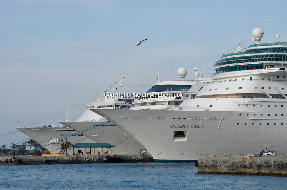 A trio of cruise ships sit at the pier in the port city of Nassau, Bahamas. (Photo by Phelan M. Ebenhack)