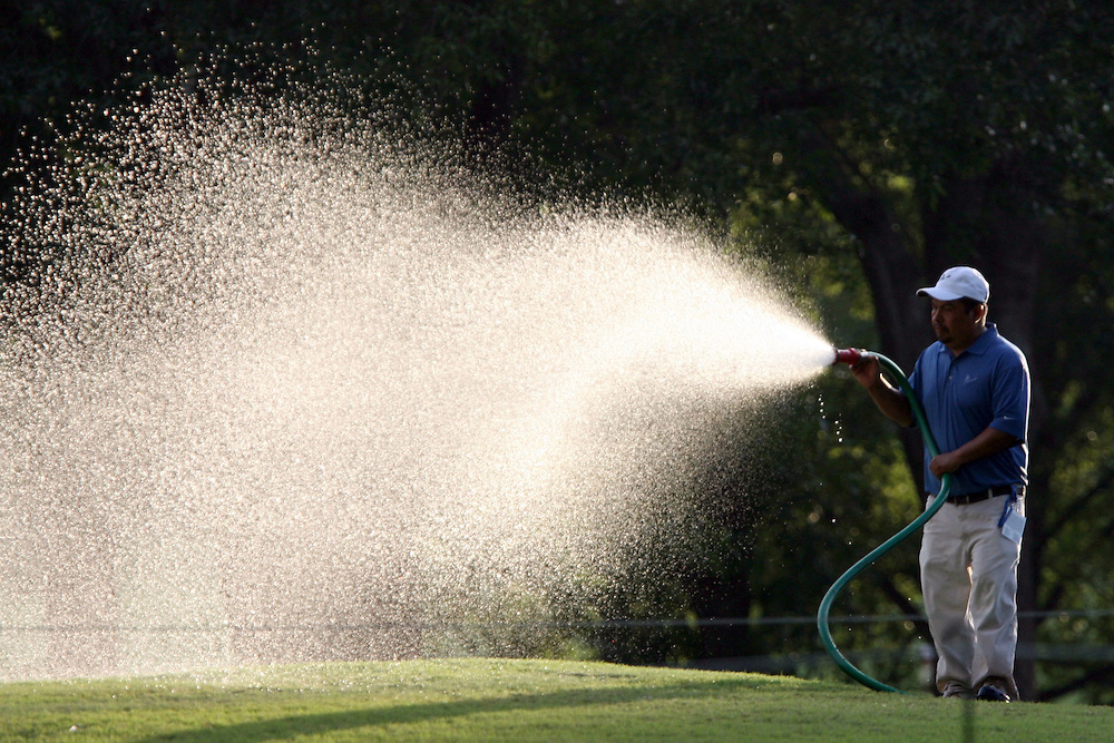 09 August 2007: A groundskeeper sprays down the No. 1 fairway prior to the start of the first round of the at the 89th PGA Championship at Southern Hills Country Club in Tulsa, OK.
