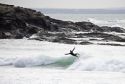 © Licensed to London News Pictures. 07/04/2020. Padstow, UK. A surfer catches a wave at Constantine Bay on the north coast of Cornwall this afternoon. The weather in the south-west is forecast to be warm in the coming days. Photo credit : Tom Nicholson/LNP