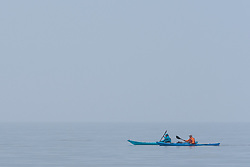 Evening Kayakers enjoy the peaceful calm of a misty Portobello evening.<br /> © Jon Davey/ EEm