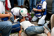 5 July 2009 - Tegucigalpa, Honduras -Medics treat a wounded child after a violent barrage of gunfire and tear gas was sent into a crowd of supporters of ousted Honduras' President Manuel Zelaya at the airport in Tegucigalpa. President Zelaya was unable to land today, but pledged to return in the coming days. His supporters have been marching in the capital's streets since he was ousted last Sunday, but the protests have increased dramatically in the last few days.