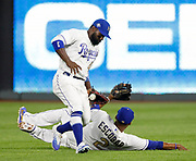 Kansas City Royals center fielder Abraham Almonte (45) and shortstop Alcides Escobar (2)  nearly collide going after a hit by New York Yankees' Aaron Hicks in the fifth inning of a baseball game at Kauffman Stadium in Kansas City, Mo., Friday, May 18, 2018. (AP Photo/Colin E. Braley)