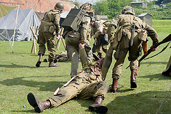 "Members of the US 82nd Airborne/505th RCT living History Group take part in the first days battle re-enactment at Fort Paull. Reenactors pulling a ""casualty"" off the field as the Americans are pushed back <br /> <br />   03 May 2015<br />   Image © Paul David Drabble <br />   www.pauldaviddrabble.co.uk"
