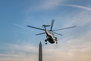 President Donald Trump rides aboard Marine One as he departs for travel to Florida from the South Lawn of the White House in Washington, U.S., November 26, 2019.