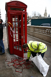 (c) London News Pictures. 10.12.2010. City Cleaners  cleaning today (Fri) up after the student protests removing graffitti, boarding up windows and removing debris from Trafalgar Square's fountains. Picture credit should read: Craig Shepheard/London News Pictures