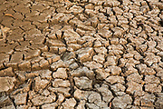 Very dry soil on farmland during the dry season in the Battambang region in Cambodia, South East Asia.  Cambodia has two seasons per year.