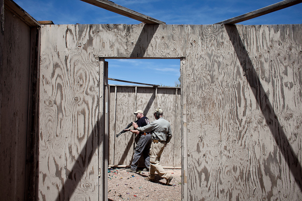 """Rangemaster Ron Fielder works with Randy Rosencrans in the live Firebox simulator during the 5-day 260 Shotgun course at Gunsite Academy.  From the Gunsite course description: Effective out to and beyond 100 yards, the defensive shotgun's flexibility and versatility demands a special set of manipulation skills, making it a """"thinking person's"""" weapons system.  When it comes to constitutional guarantees, Second Amendment champions see firearm ownership as """"the first right"""" because it empowers citizens to defend all other rights.  And, in Arizona, that sense of self-reliance is particularly strong."""