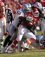 Kansas City Chiefs running back Larry Johnson (27) gets stuffed at the line by Oakland Raiders linebacker Thomas Howard (53) in the second quarter at Arrowhead Stadium in Kansas City, Missouri, November 19, 2006.  The Chiefs beat the Raiders 17-13.<br />
