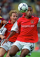 Thierry Henry (Arsenal) supported by Ray Parlour. Bradford City 1:1 Arsenal, F.A. Carling Premiership, 9/9/2000. Credit Colorsport / Stuart MacFarlane.