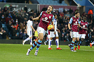 Rudy Gestede of Aston Villa celebrates after he  scores his teams 1st goal to make it 1-1.  Barclays Premier league match, Aston Villa v Leicester city at Villa Park in Birmingham, The Midlands on Saturday 16th January 2016.<br /> pic by Andrew Orchard, Andrew Orchard sports photography.