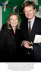 MR & MRS JOHNNY KIDD parents of model Jodie Kidd, at a party in London on 14th March 2001.	OMF 102