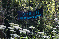 A banner placed by activists from HS2 Rebellion in Denham Country Park on 26th June 2020 in Denham, United Kingdom. Activists from HS2 Rebellion and Extinction Rebellion UK are taking part in a 'Rebel Trail' hike along the route of the HS2 high-speed rail link in protest against its environmental impact and to question the viability of the £100bn+ project.