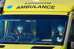 © Licensed to London News Pictures. 02/01/2021. London, UK. Paramedics wearing protective face coverings in an ambulance respond to an emergency in north London. <br /> The President of the Royal College of Physicians,Professor Andrew Goddard, has warned that COVID-19 infection cases are set to rise in the coming weeks and that NHS staff and healthcare workers are worried about the challenges against the virus over the coming months. Photo credit: Dinendra Haria/LNP