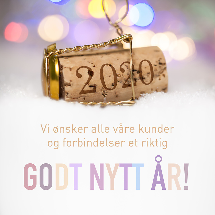 Nyttårshilsen i form av Champagne-kork med innpreget årstall 2020, tekst «Vi ønsker alle våre kunder og forbindelser et riktig godt nytt år!».