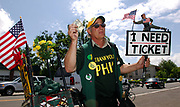 A track and field fan searches for a ticket to buy atthe 31st Prefontaine Classic, Saturday, June 4, 2005, in Eugene, Ore.