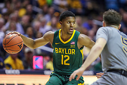 Mar 7, 2020; Morgantown, West Virginia, USA; Baylor Bears guard Jared Butler (12) dribbles while defended by West Virginia Mountaineers guard Jordan McCabe (5) during the first half at WVU Coliseum. Mandatory Credit: Ben Queen-USA TODAY Sports