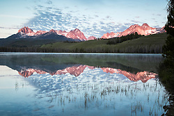 Sunrise at Little Redfish Lake as the Sawtooth Mountain Range reflects in it's waters.  This central Idaho gem is in Stanley Idaho's Sawtooth National Recreation Area.