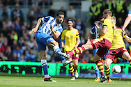 Brighton central defender, Connor Goldson (17) shoots and goes close during the Sky Bet Championship match between Brighton and Hove Albion and Burnley at the American Express Community Stadium, Brighton and Hove, England on 2 April 2016.