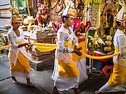19 JULY 2016 - TAMPAKSIRING, GIANYAR, BALI, INDONESIA: Dancers file through the main prayer area of Pura Agung temple on the first day of a ceremony to honor the anniversary of the temple, one of the most important Hindu temples on Bali. This year's ceremony is the most important in years because it falls on the 50 year cycle of the temple's founding. This year's ceremony lasts for 11 days.      PHOTO BY JACK KURTZ