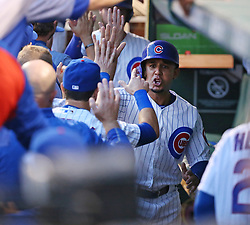August 14, 2017 - Chicago, IL, USA - Chicago Cubs left fielder Jon Jay (30) gets high fives in the dugout after he scored on the double by Chicago Cubs first baseman Anthony Rizzo (44) during the first inning of their game at Wrigley Field Monday Aug. 14, 2017 in Chicago. (Credit Image: © Nuccio Dinuzzo/TNS via ZUMA Wire)