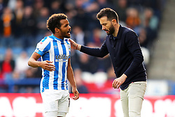 Huddersfield Town manager Carlos Corberan (right) and midfielder Duane Holmes speak on the touchline during the Sky Bet Championship match at the John Smith's Stadium, Huddersfield. Picture date: Saturday October 16, 2021.