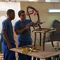 Central America, Cuba, Havana. Furniture restoration workshop in Havana.