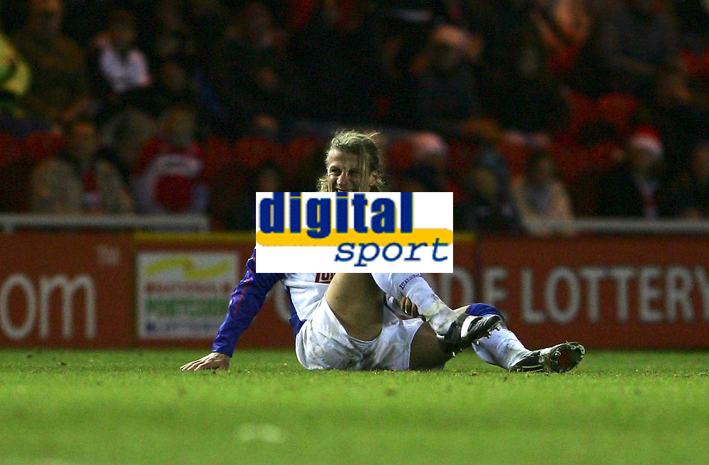 Photo: Andrew Unwin.<br /> Middlesbrough v Blackburn Rovers. Carling Cup. 21/12/2005.<br /> Blackburn's Robbie Savage feels the pain after a challenge.