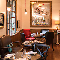 """Interior dining room of the Golden Fleece, a Greek-inspired """"slow earth kitchen"""" restaurant run by Greek chef George Delidimos located at 111 Grovewood Road in Asheville, North Carolina."""