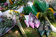 Two pairs of Amy Winehouse's actual shoes brought down by a friend of hers at a memorial opposite the home of Amy Winehouse, Camden Square, North London. Fearing they would be taken the friend then romoved the shoes and gave one pair to a distressed fan. It was announced that the tragic singer had died on 23rd July 2011. The music world has been paying tribute to singer Amy Winehouse, 27, who was found dead at her London home following years of drug and alcohol abuse largely attributed to her troubled character and fame.