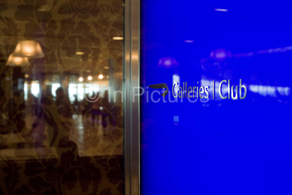 """We see a welcome screen at the British Airways Galleries Club lounge at Heathrow Airport's Terminal 5. This exclusive facility is only available to passengers travelling open to passengers travelling in First, Club World and Club Europe as well as Gold and Silver Executive Club members and was designed by Artwise. The lounge's 15,000 sq ft complex was built at the cost of £60 million. From writer Alain de Botton's book project """"A Week at the Airport: A Heathrow Diary"""" (2009)."""