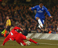 Photo. Daniel Hambury, Digitalsport<br /> Chelsea v Liverpool.<br /> <br /> Carling Cup Final.<br /> 27/02/2005<br /> Chelsea's Didier Drogba is stopped by Liverpool's Sami Hyypia.