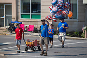A man sells balloons at an Independence Day parade in Millville, Pennsylvania on July 5, 2021.