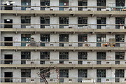 A view of a workers' dormitory that is slated for demolition at the site of a decommissioned factory in Wuxi, Jiangsu Province, China on 26 September 2013. As China struggles with increasing air pollution, many local governments are forced to close down older factories, creating unemployment and poverty as a result.