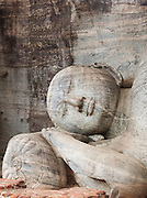 Statue of Buddha lying down at the ancient city of Polonnaruwa, Sri Lanka