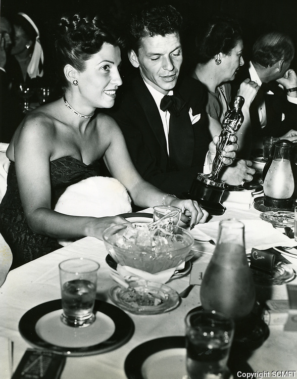 1946 Frank Sinatra and wife, Nancy, admire his Oscar at Ciro's Nightclub in West Hollywood