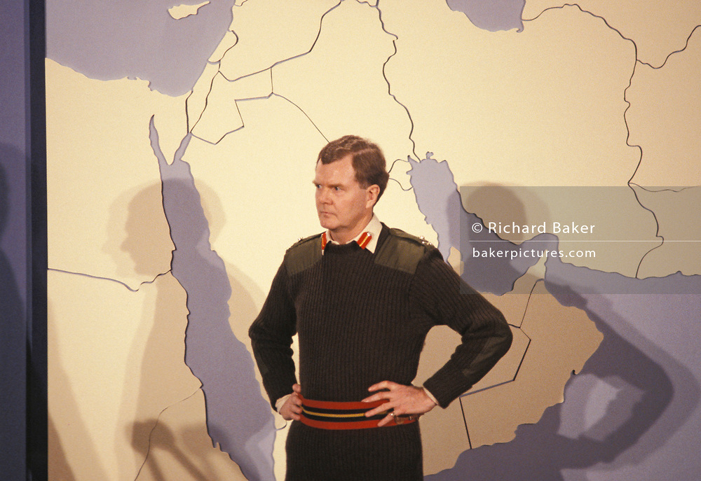Using a map of the middle-eastern Gulf region, Major General Alex Harley, Director of Operations during the Gulf War, briefs the media at the Ministery of Defence, on 10th August 1990, in London, England. General Sir Alexander George Hamilton Harley, KBE, CB (born 1941) is now a retired British Army officer and former Adjutant-General to the Forces.