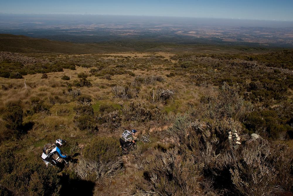 Location: Mont Kenya (Kenya) Urge Kenya 09/ The ultimate Mountain Bike gravity adventure at Mont-Kenya Athlete: Rene Wildhaber and Darren Berrecloth training on the race track between between Old Moses camp (altitude 3300 meters) and Shipton Camps (altitude 4200 meters)