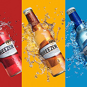 Three flavours of Bacardi Breezer, Strawberry, Orange and Blueberry Ray Massey is an established, award winning, UK professional  photographer, shooting creative advertising and editorial images from his stunning studio in a converted church in Camden Town, London NW1. Ray Massey specialises in drinks and liquids, still life and hands, product, gymnastics, special effects (sfx) and location photography. He is particularly known for dynamic high speed action shots of pours, bubbles, splashes and explosions in beers, champagnes, sodas, cocktails and beverages of all descriptions, as well as perfumes, paint, ink, water – even ice! Ray Massey works throughout the world with advertising agencies, designers, design groups, PR companies and directly with clients. He regularly manages the entire creative process, including post-production composition, manipulation and retouching, working with his team of retouchers to produce final images ready for publication.