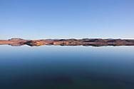 El-Mansour Eddabbi dam with mountain reflections in Ouarzazate, Morocco.