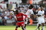 Wilfried Bony of Swansea city challenges Abdoulaye Doucoure of Watford (l).  Premier league match, Swansea city v Watford at the Liberty Stadium in Swansea, South Wales on Saturday 23rd September 2017.<br /> pic by  Andrew Orchard, Andrew Orchard sports photography.