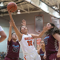 Gallup Bengal Michaela McCurtain (32) drives to the basket in their district 1-4A championship game against the Shiprock Chieftains Saturday night at Gallup High School in Gallup. The Bengals beat the Chieftains 72-57.