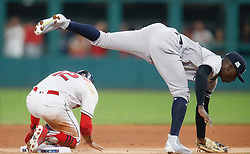 October 5, 2017 - Cleveland, OH, UKR - The Cleveland Indians' Fracisco Lindor, left, is tagged out at second by New York Yankees shortstop Didi Gregorius in first inning in Game 1 of the American League Division Series on Thursday, Oct. 5, 2017, at Progressive Field in Cleveland. (Credit Image: © Leah Klafczynski/TNS via ZUMA Wire)