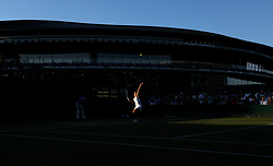 Kirsten Flipkens serves on day two of the Wimbledon Championships at the All England Lawn Tennis and Croquet Club, Wimbledon.